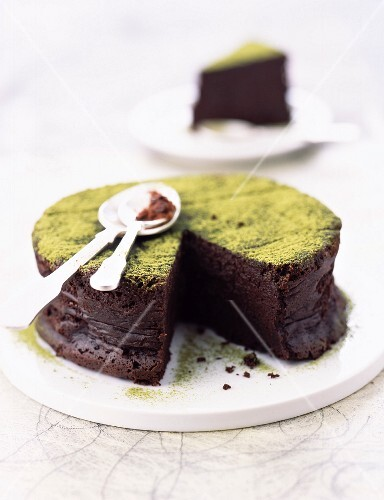 Bitter chocolate Fondant cake powdered with matcha green tea