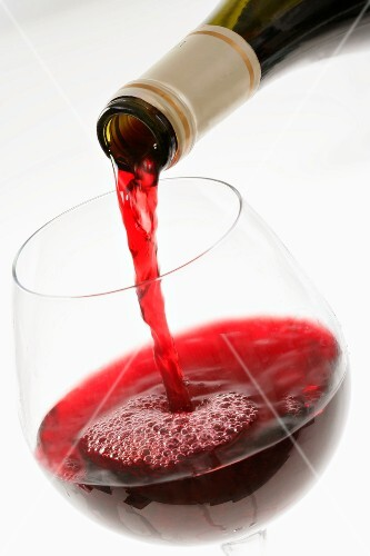 Pourring a glass of red wine