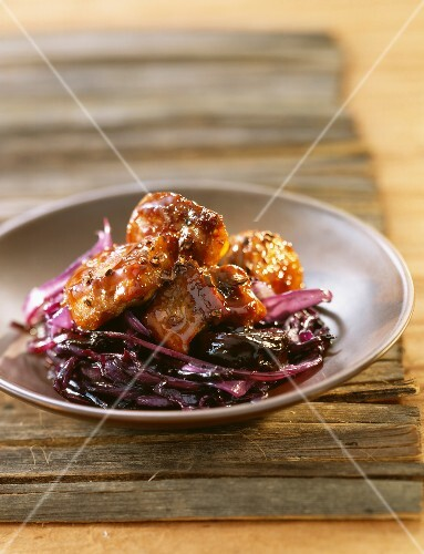 Caramelized duck with red cabbage and prunes and coffee sauce