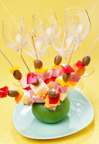 Party skewers with olives, cheese, salami and red peppers