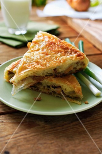 Two slices of meat and spring onion pie
