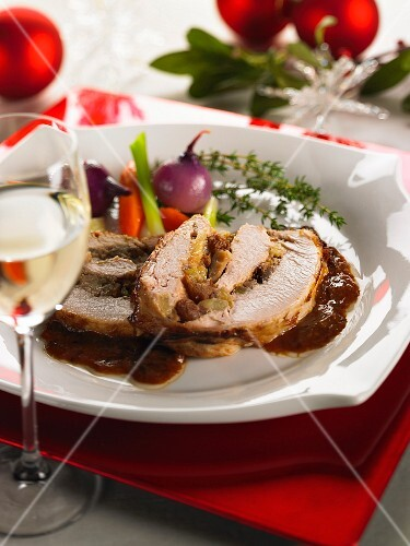 Stuffed roast pork with chestnuts and raisins