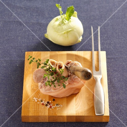 Raw veal knuckle on a chopping board