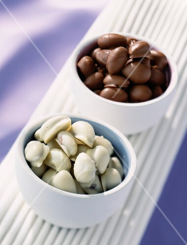 Two types of chocolate almonds in bowls