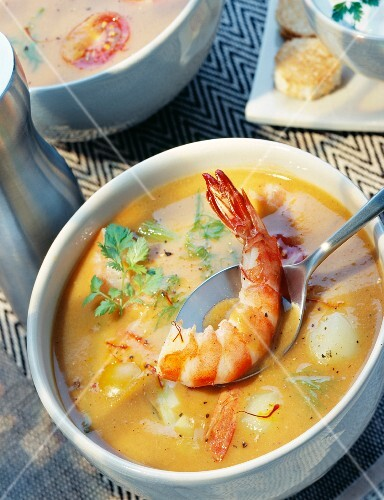 Tomato and vegetable soup with prawns