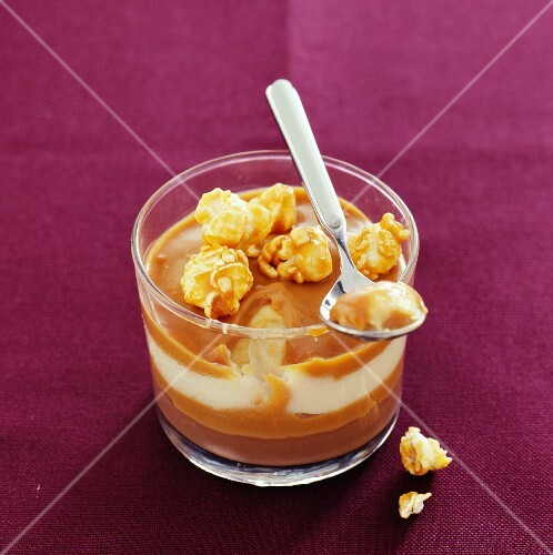 A caramel and popcorn dessert in a glass