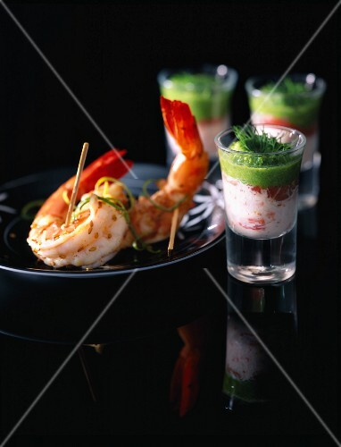 Crab jelly in glasses and prawns with sesames seeds