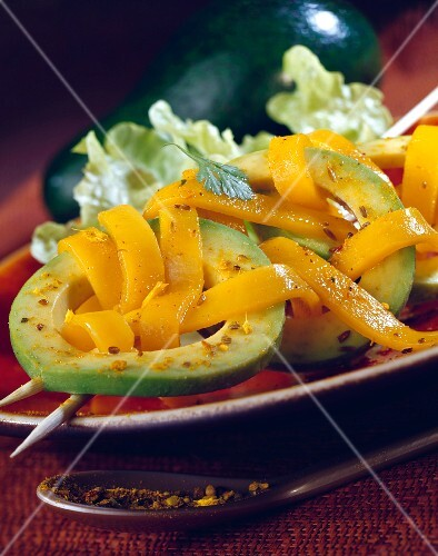 Avocado Carpaccio with thin strips of mango