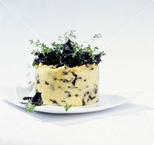 Polenta timbale with black trumpet