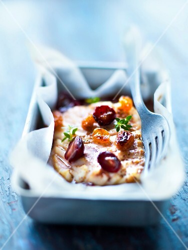 Piece of cod with grapes and raisins