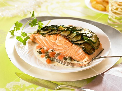 Thick piece of salmon covered with zucchini scales