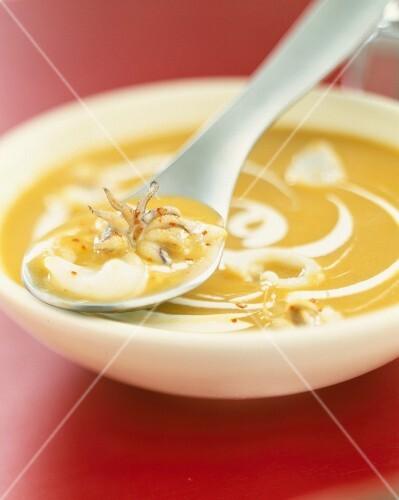 Cream of vegetable soup with small squid