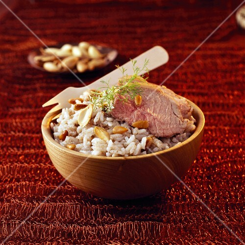 Sliced leg of lamb with pilaf rice and dried fruit