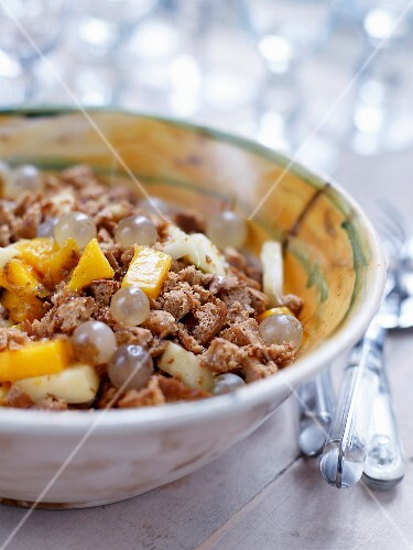 Autumn fruit salad with crumbled gingerbread