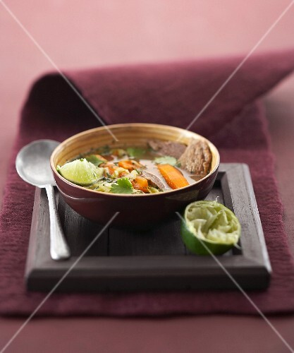 Beef broth with vegetables and coriander