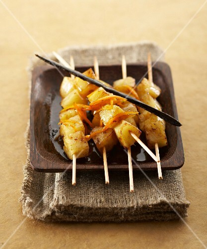 Pineapple brochettes with sweet wine syrup