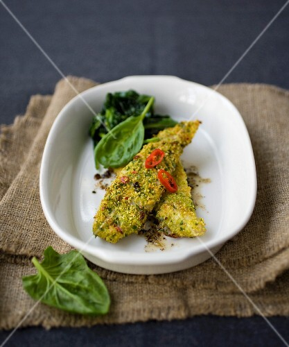 Fish fillets coated with breadcrumbs and hot red pepper