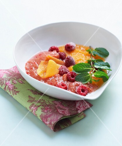 Cream of melon and watermelon soup with raspberries