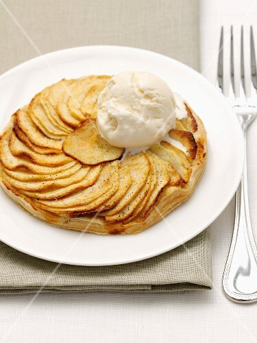 Flaky pastry apple tart and a scoop of ice cream