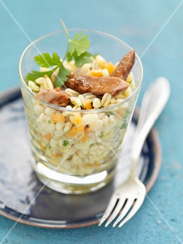 Wheat salad with thinly sliced duck's breast