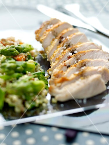 Sliced chicken breast with bulghour tabbouleh with asparagus
