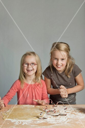 Young girls making pastries