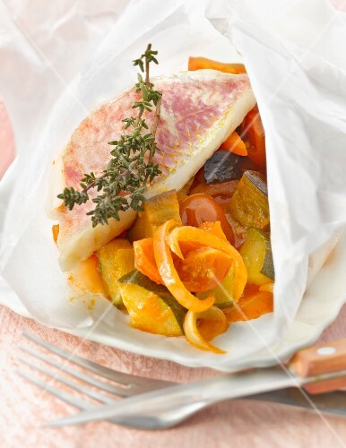 Red mullet and ratatouille cooked in wax paper