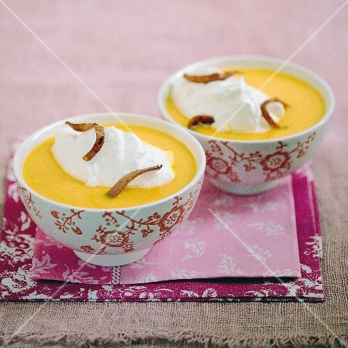 Cream of carrot soup with diced bacon