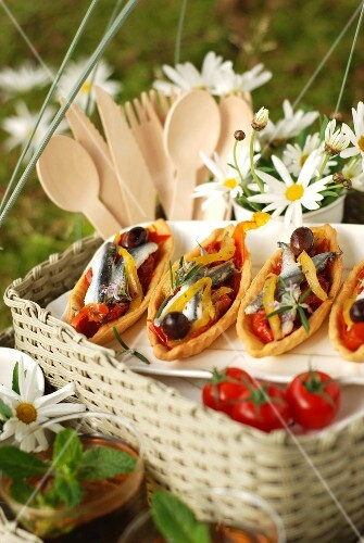 Anchovy fillets,stewed pepper,olive and rosemary savoury tartlet