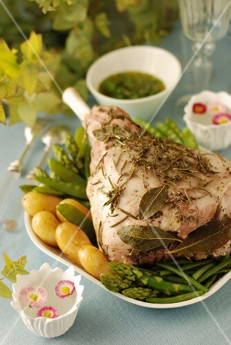 Shoulder of lamb cooked with herbs in a cloth