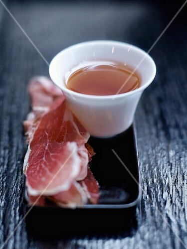 Cup of tea and thin slices of Spanish ham