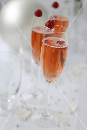 Glasses of Champagne with raspberries