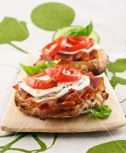 Tomato, mozzarella, Parma ham and basil toasted open sandwich