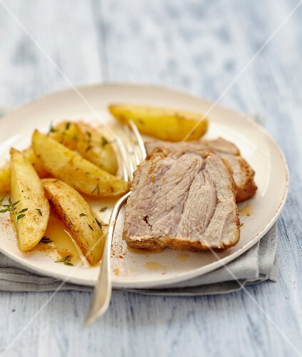 Roast pork marinated in spices,fried potatoes with thyme