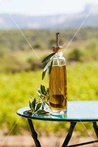 Bottle of olive oil on a table outdoors