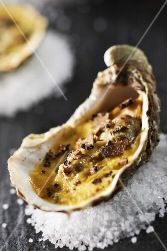 Hot oyster cooked with truffles and Champagne