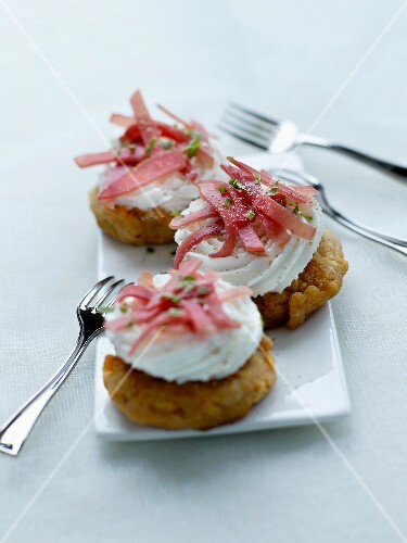 Eggplant fritters with salty whipped cream and short strips of Aoste ham