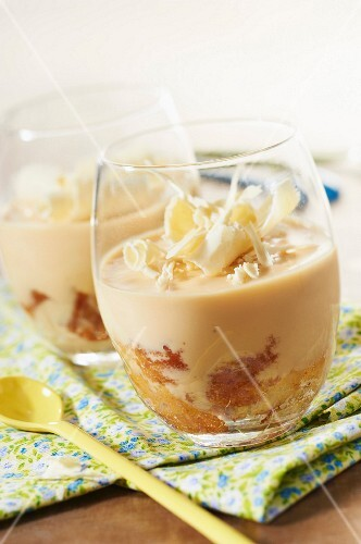 Almond-flavored coffee cream dessert with white chocolate flakes