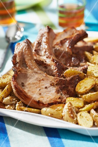 Pork chops with grain mustard,sauteed potatoes with sesame seeds