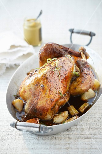 Roasted guinea-fowl with mustard and spring onions