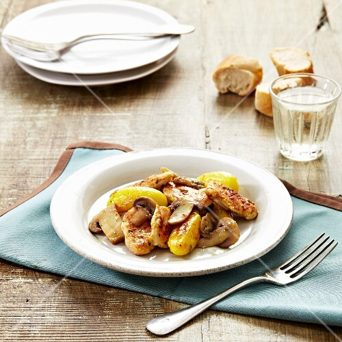 Thinly sliced chicken breasts with sauteed potatoes