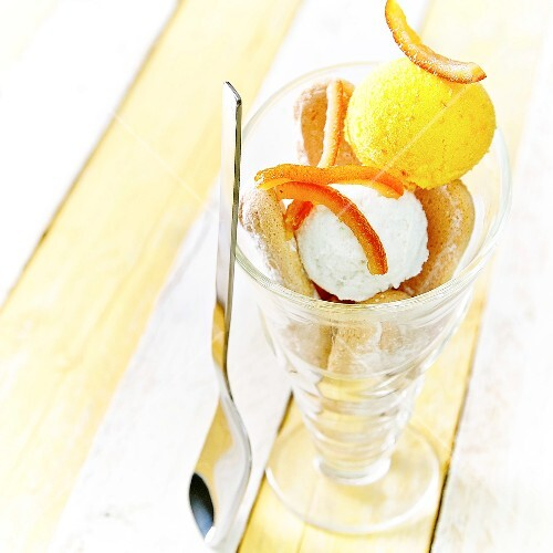 Lemon and orange sorbet with confit orange rinds and finger biscuits