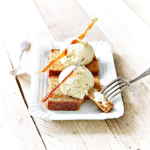 Vanilla ice cream on sliced gingerbread and topped with caramel sticks