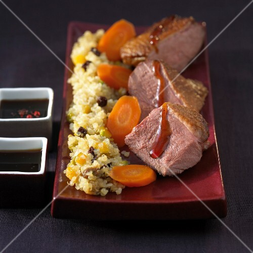 Duck magret with honey sauce,quinoa with raisins and carrots