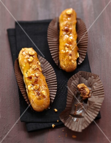Chocolate Eclairs with caramel frosting and crushed hazelnuts