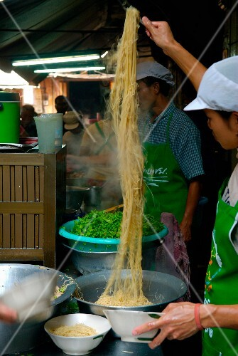 Preparing noodles in the street