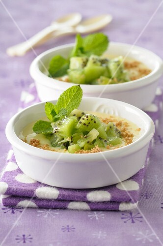 Almond cream dessert with diced kiwi and mint