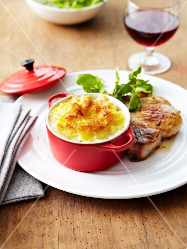 Potato gratin casserole and pork chops