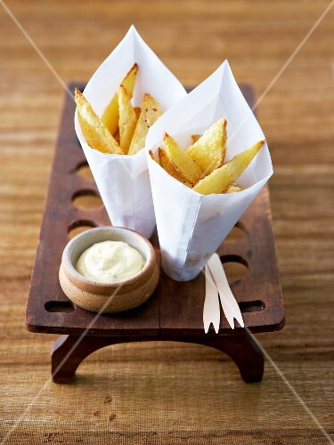 Small cones of homemade french fries and truffle-flavored mayonnaise