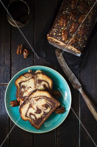 Chocolate marble cake topped with caramelised pecan nuts